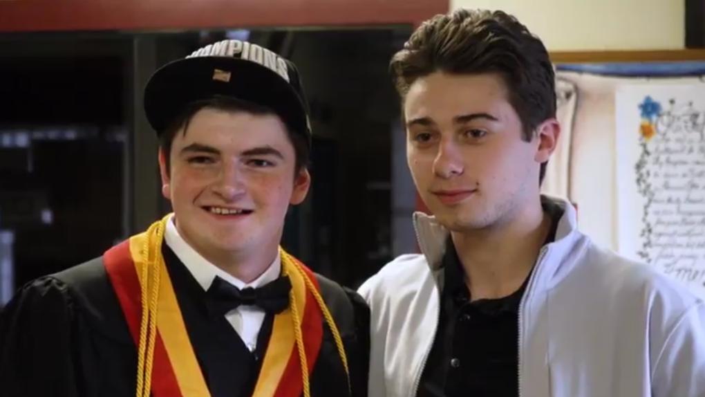 'It's surreal': Vancouver Canuck Quinn Hughes surprises fan with autism at graduation