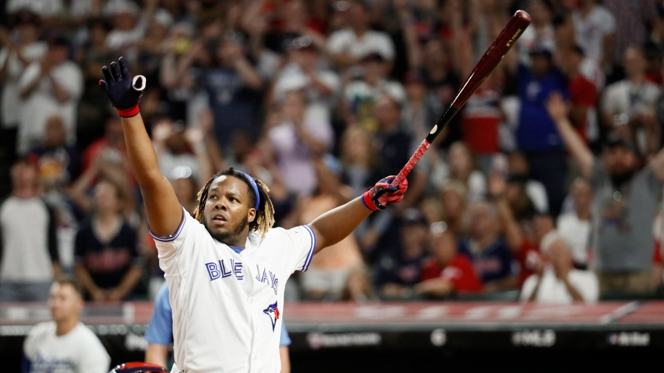Vladimir Guerrero Jr., of the Toronto Blue Jays, reacts to a hit during the Major League Baseball Home Run Derby, Monday, July 8, 2019, in Cleveland. (AP Photo/John Minchillo)