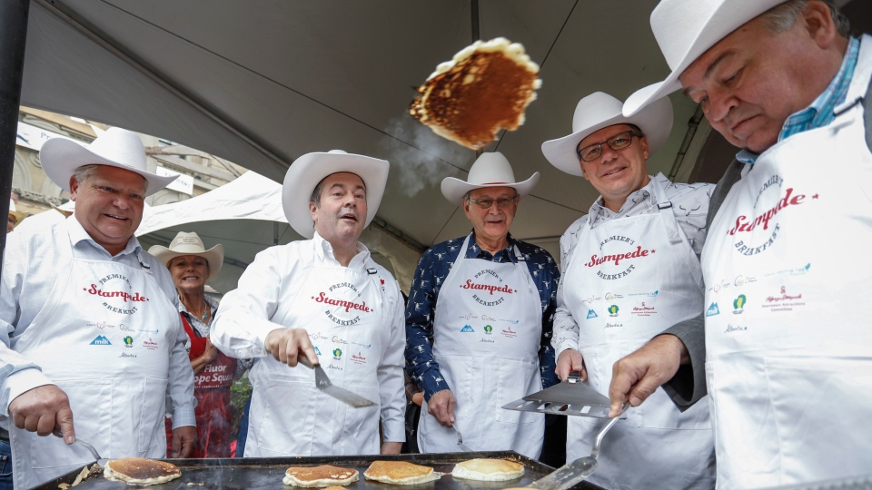 Alberta Premier Jason Kenney, second left, hosts a Stampede breakfast with visiting premiers, left to right, Doug Ford, of Ontario, Blaine Higgs, of New Brunswick, Scott Moe, of Saskatchewan, and Robert McLeod, of the Northwest Territories,in Calgary, Monday, July 8, 2019. (THE CANADIAN PRESS/Jeff McIntosh)
