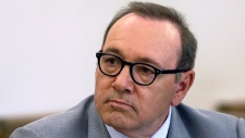 FILE - In this June 3, 2019, file photo, actor Kevin Spacey attends a pretrial hearing at district court in Nantucket, Mass. The man who accused Kevin Spacey of groping him at a bar has denied deleting or altering text messages about the alleged 2016 assault. The man's lawyer said Monday, July 8, 2019, they cannot find the phone but have recovered a copy of its contents that were backed up to a computer. (AP Photo/Steven Senne, File)