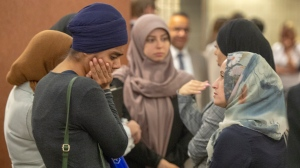 People wait to enter the courtroom for a hearing challenging Bill 21, Quebec's religious symbols law, Tuesday, July 9, 2019 in Montreal. (THE CANADIAN PRESS / Ryan Remiorz)