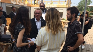 Provincial Labour Minister Jean Boulet talks with visual graphics workers from Rodeo FX and Scanline VFX in Montreal on July 9, 2019. (Ken Dow/CTV Montreal)