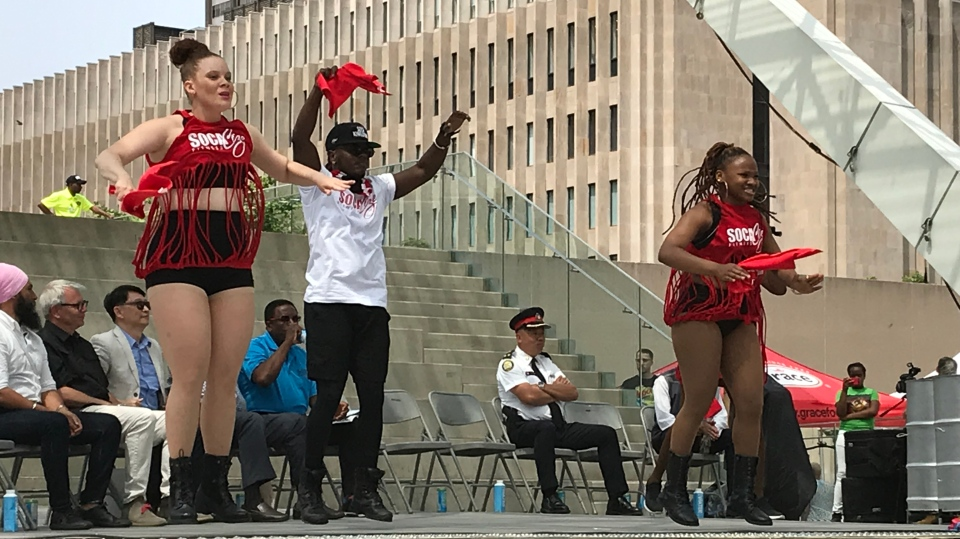 Participants start a warm-up at city hall during the launch of the 52 annual Toronto Caribbean Carnival.