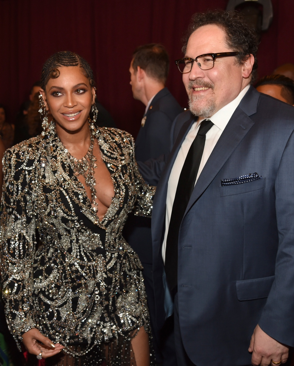 """Beyonce, left, and Jon Favreau arrive at the world premiere of """"The Lion King"""" on Tuesday, July 9, 2019, at the Dolby Theatre in Los Angeles. (Photo by Chris Pizzello/Invision/AP)"""