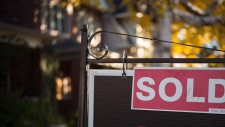 A real estate sold sign hangs in front of a west-end Toronto property on November 4, 2016. THE CANADIAN PRESS/Graeme Roy