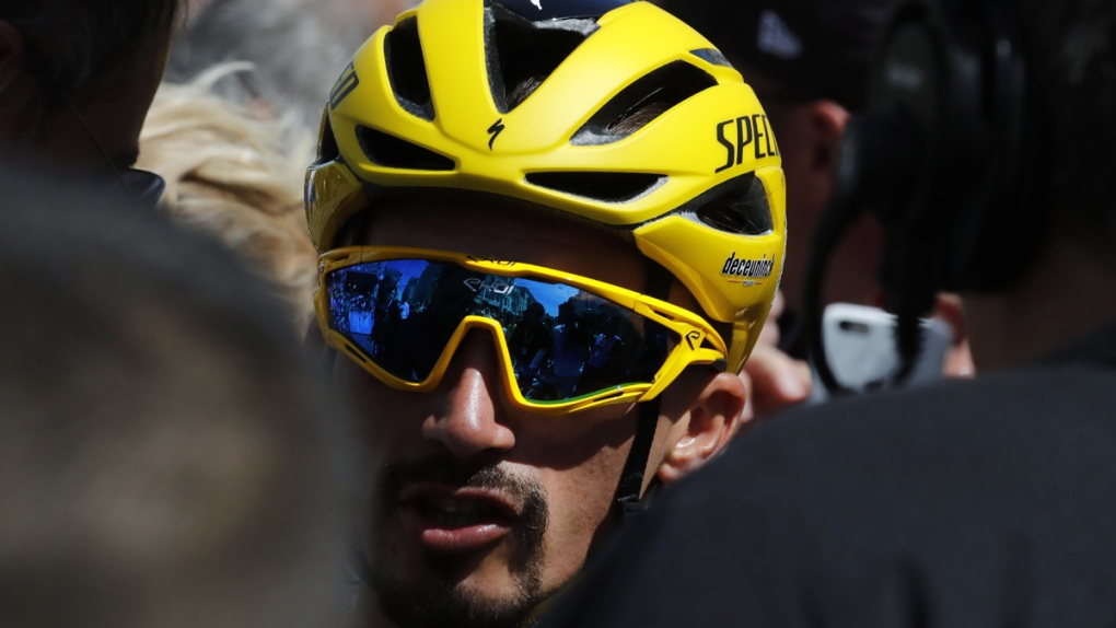 Julian Alaphilippe wearing the yellow jersey