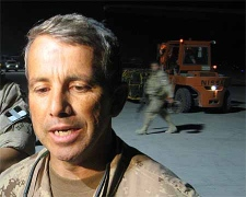 Brig.-Gen. Guy Laroche speaks to reporters at the Kandahar airfield Friday night, July 27, 2007. Laroche is the new commander of Joint Task Force (Afghanistan). (CP PHOTO/Martin Ouellet)