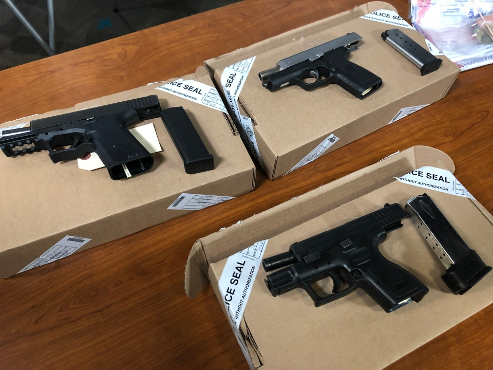 Handguns displayed as Toronto police provided an update into 'Project Oz' on July 10, 2019 are seen. (CTV News Toronto / Corey Baird)