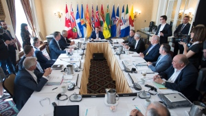 Canada's Premiers listen as Saskatchewan Premier Scott Moe addresses them during a meeting of Canada's Premiers in Saskatoon, Sask. Wednesday, July 10, 2019. THE CANADIAN PRESS/Jonathan Hayward
