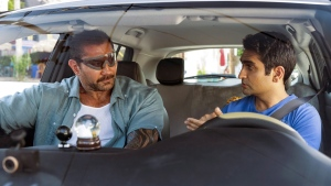 Dave Bautista, left, and Kumail Nanjiani in a scene from 'Stuber.' (Mark Hill/20th Century Fox via AP)