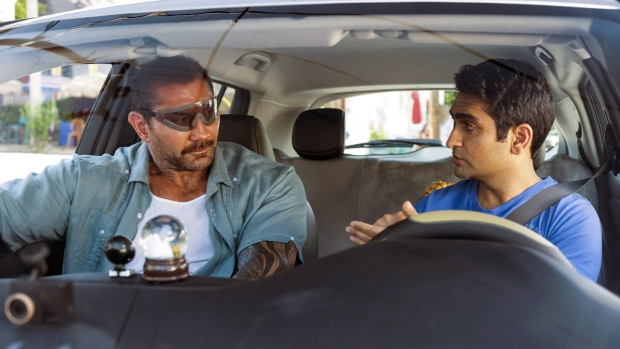 Dave Bautista, left, and Kumail Nanjiani in a scene from 'Stuber.' (Mark Hill/20th Century Fox via AP)