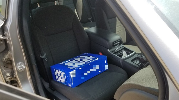 A case of beer allegedly used as a booster seat
