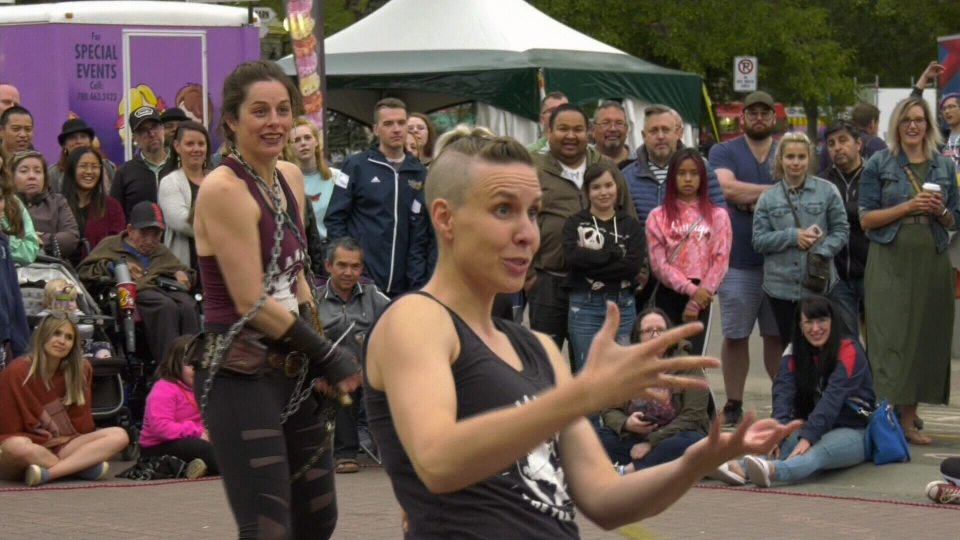 Tianna the Traveller is using a sign language interpreter in her act at the Edmonton International Street Performers Festival.