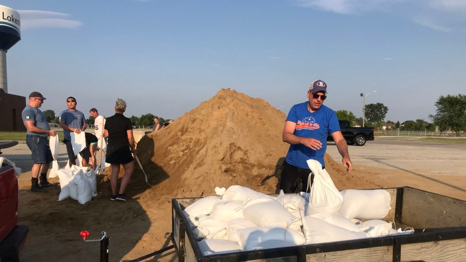 A number of OPP volunteers help residents in Lakeshore fill sandbags on July 10, 2019. ( Alana Hadadean / CTV Windsor )