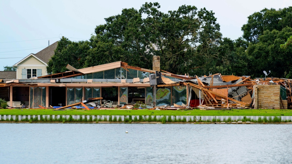 This photo shows the damaged home of Eric and Indra Ehlenberger in New Orleans on Wednesday, July 10, 2019, following a storm that went through the area. (AP Photo/Matthew Hinton)