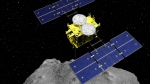 FILE - This computer graphics image released by the Japan Aerospace Exploration Agency (JAXA) shows the Hayabusa2 spacecraft above the asteroid Ryugu. (ISAS/JAXA via AP)