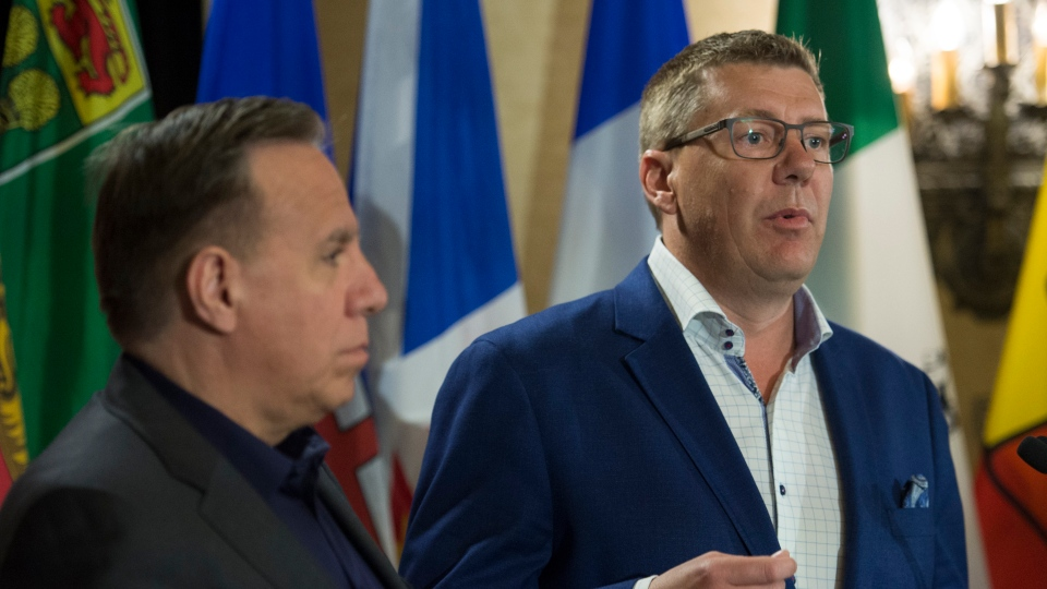 Saskatchewan Premier Scott Moe, right and Quebec Premier Francois Legault address the media during a meeting of Canada's Premiers in Saskatoon, Sask, Wednesday, July 10, 2019. THE CANADIAN PRESS/Jonathan Hayward
