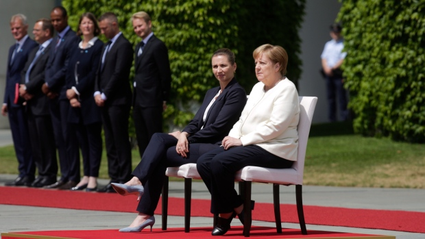 Angela Merkel sits during welcoming ceremony following third public shaking incident