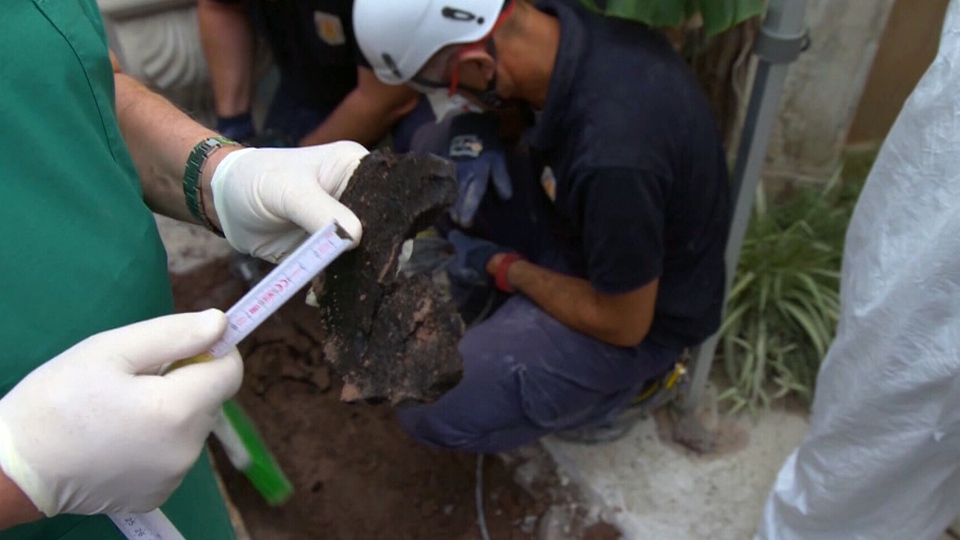 Vatican officials opened two graves at its Teutonic Cemetery as part of an effort to solve a 1983 missing person's case.