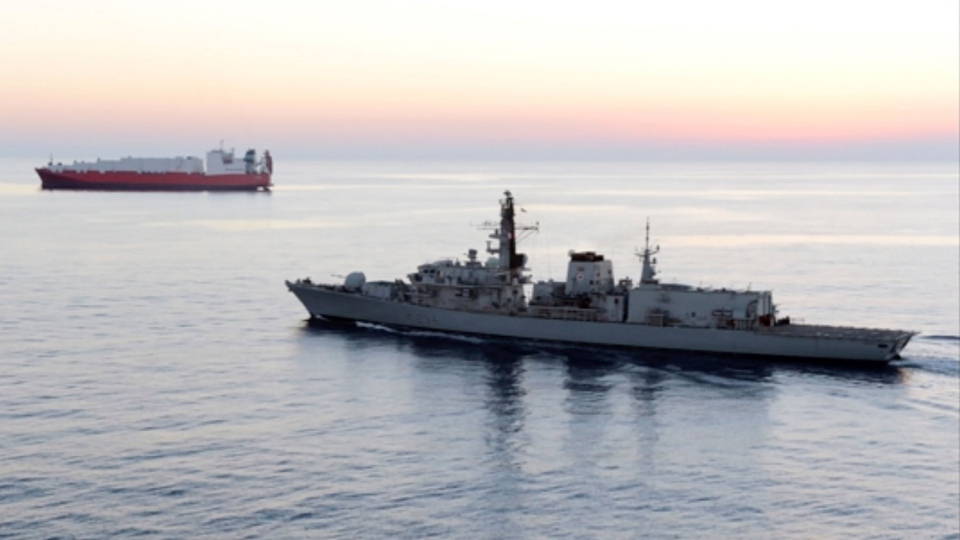 In this image from file video provided by UK Ministry of Defence, British navy vessel HMS Montrose escorts another ship during a mission to remove chemical weapons from Syria at sea off coast of Cyprus in February 2014.(UK Ministry of Defence via AP)