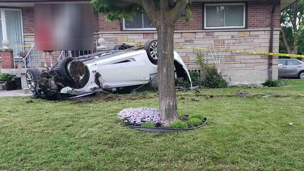 A car on its roof on a lawn