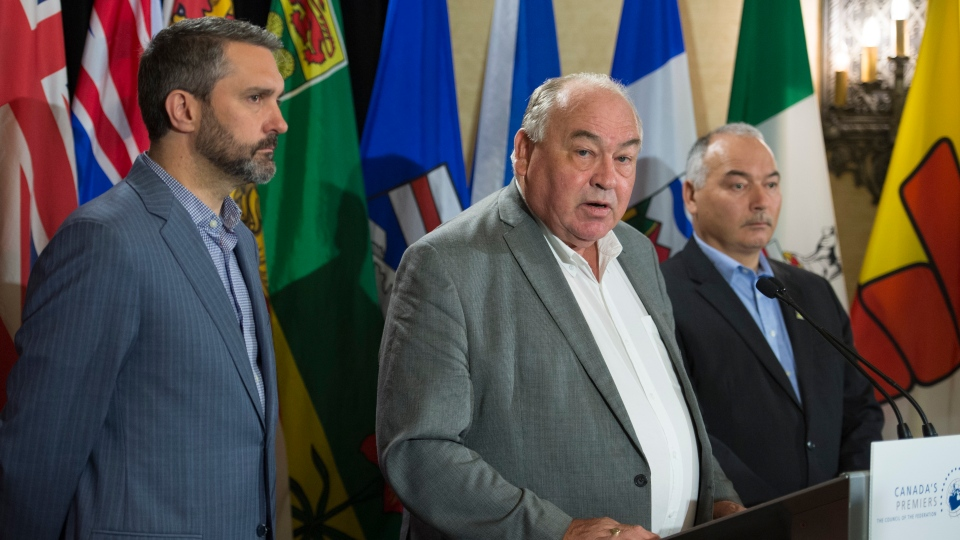 Yukon Premier, Sandy Silver, left to right, Bob McLeod of Northwest Territories and Joe Savikataaq of Nunavut speak to the media during a meeting of Canada's Premiers in Saskatoon, Sask. Thursday, July 11, 2019. THE CANADIAN PRESS/Jonathan Hayward