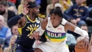 New Orleans Pelicans forward Stanley Johnson (3) drives on Indiana Pacers guard Wesley Matthews (23) during the second half of an NBA basketball game in Indianapolis, Friday, Feb. 22, 2019. The Pacers won 126-111. (AP Photo/Michael Conroy)