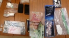 Drugs and cash allegedly seized from a drug bust in Bolton is displayed. (Caledon OPP)