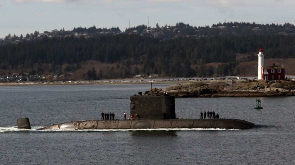 The Royal Canadian Navy says the 56 sailors aboard HMCS Chicoutimi when it caught fire in 2004 were 45 times more likely to be diagnosed with PTSD than a control group made up of healthy submariners. The HMCS Chicoutimi is seen here passing by Fisgard Lighthouse as it arrives at CFB Esquimalt in March 2018.  (THE CANADIAN PRESS/Chad Hipolito)