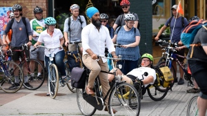 NDP leader Jagmeet Singh participates in a group bike ride with Ottawa Centre residents, after announcing his party's vision for a national cycling strategy in Ottawa on Thursday, July 11, 2019. THE CANADIAN PRESS/Justin Tang