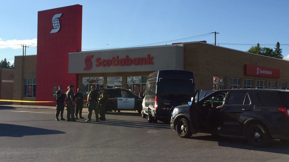 Police surround the Scotiabank in Orillia on Thurs., July 11, 2019 (CTV News/Steve Mansbridge)
