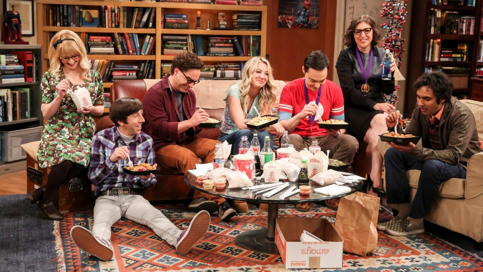 """This photo provided by CBS shows Melissa Rauch, from left, Simon Helberg, Johnny Galecki, Kaley Cuoco, Jim Parsons, Mayim Bialik and Kunal Nayyar in a scene from the series finale of """"The Big Bang Theory."""" (Michael Yarish/CBS via AP)"""