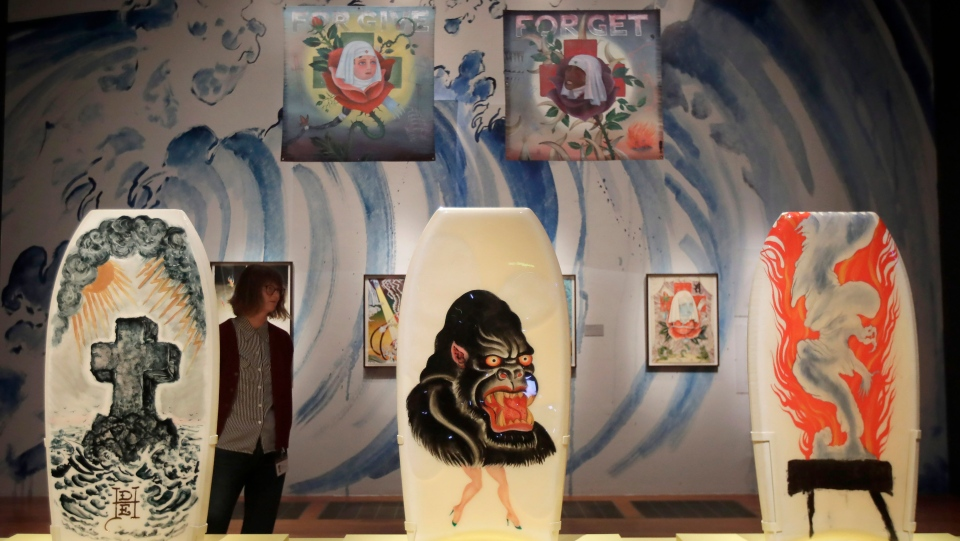 """In this Wednesday, July 10, 2019 photo, boogie boards designed by Ed Hardy are displayed during a media preview of """"Ed Hardy: Deeper than Skin"""" at the de Young Museum in San Francisco. (AP Photo/Jeff Chiu)"""