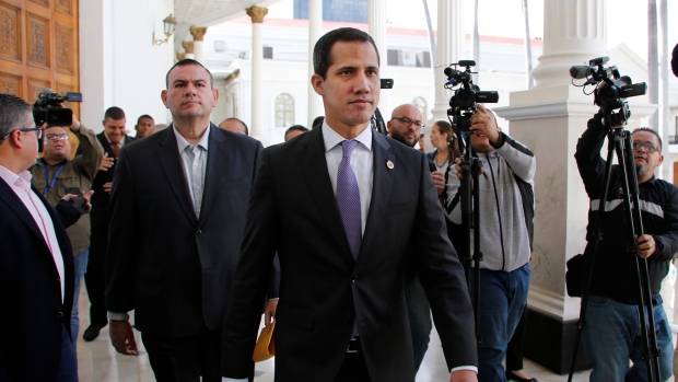 Venezuela's opposition leader and self-proclaimed interim president Juan Guaido arrives at the National Assembly building in Caracas, Venezuela, Tuesday, July 9, 2019. (AP Photo/Leonardo Fernandez)
