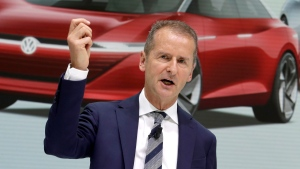 In this Aug. 1, 2018 file photo Herbert Diess, CEO of the Volkswagen stock company, addresses the media during a press conference in Wolfsburg, Germany. A person briefed on the matter says Volkswagen will invest $2.6 billion in a Pittsburgh autonomous vehicle company that's mostly owned by Ford. The number is part of a broader partnership on electric and self-driving vehicles that Ford and the German automaker will announce Friday, July 12, 2019 in New York.(AP Photo/Michael Sohn, file)