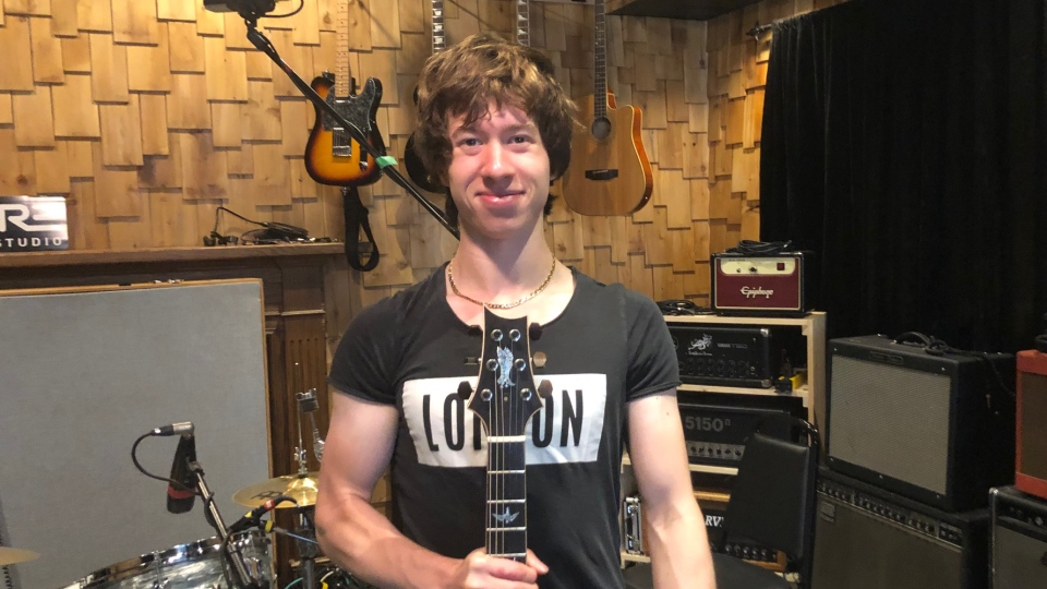 Christian Vegh poses with his PRS Guitar in Empire Recording Studio in Windsor, Ont., on Thursday, July 12, 2019. (Melanie Borrelli / CTV Windsor)