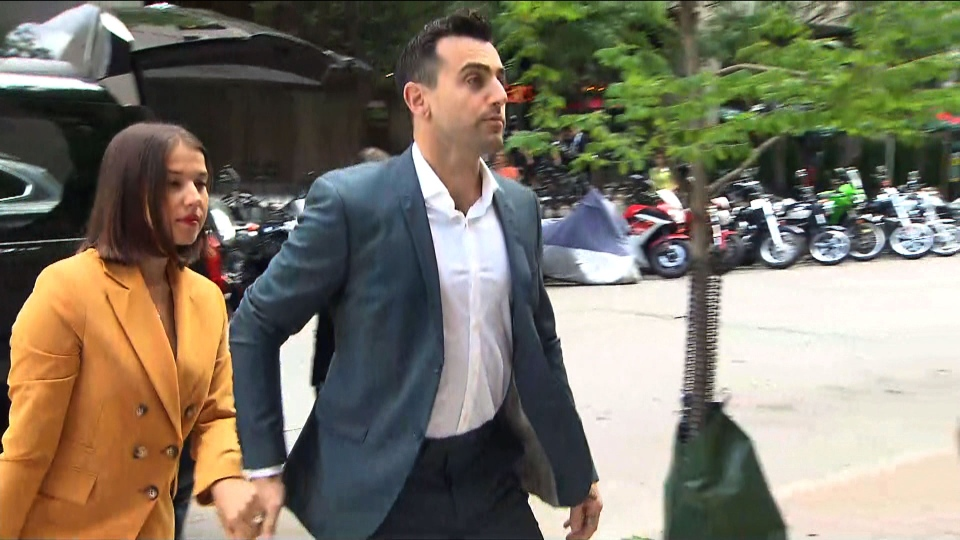 Jacob Hoggard arrives at court with his wife, Rebekah Asselstine, on July 12, 2019.