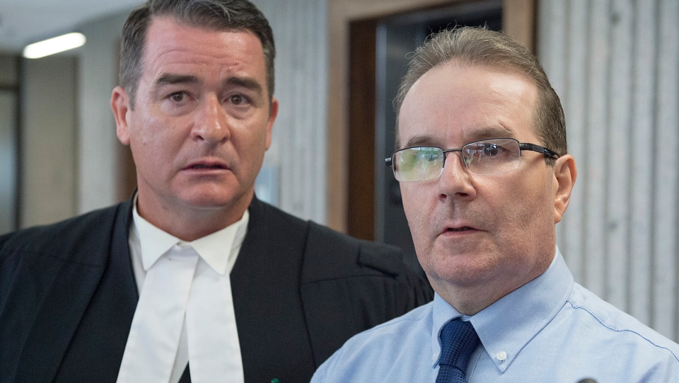 Glen Assoun, the Nova Scotia man who spent almost 17 years in prison for a crime he didn't commit, and his lawyer Sean MacDonald talk to reporters outside Supreme Court in Halifax on Friday, July 12, 2019. A judge had ordered the full release of a federal Justice Department report that led to the exoneration of Assoun, wrongfully convicted of murder. THE CANADIAN PRESS/Andrew Vaughan
