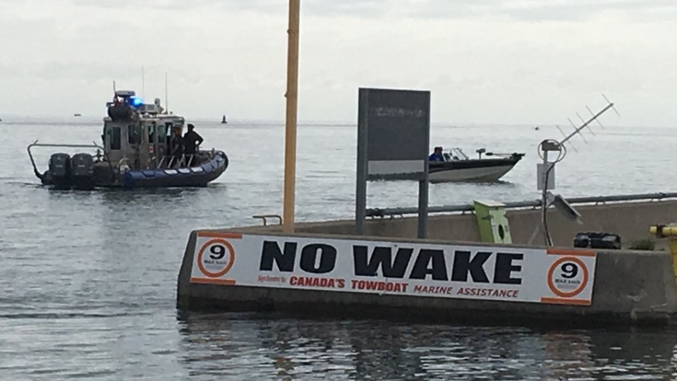 A No Wake sign is visible along the shoreline in Windsor, Ont., on Friday, July 12, 2019. (Chris Campbell / CTV Windsor)