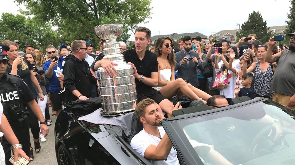 Jordan Binnington is seen holding the Stanley Cup while cruising through his hometown of Richmond Hill on July 11, 2019. (CTV News Toronto / Brian Weatherhead)