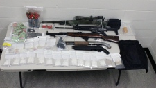 Drugs, guns and ammunition seized by police in Red Deer and Sylvan Lake are displayed. (Supplied)