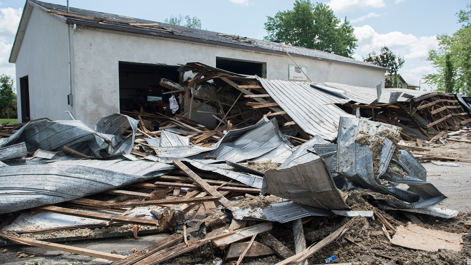Debris from a barn is shown following a tornado in Saint-Roch-de-l'Achigan, Que. near Montreal, Friday, July 12, 2019. THE CANADIAN PRESS/Graham Hughes