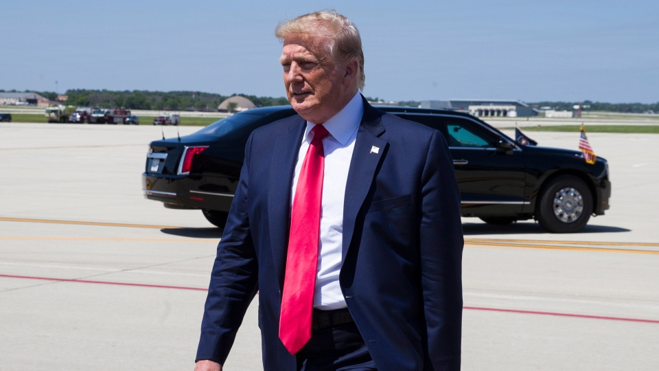 U.S. President Donald Trump walks to greet supporters as he arrives at General Mitchell International Airport, Friday, July 12, 2019, in Milwaukee. (AP Photo/Alex Brandon)