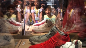 An excited child views the exhibit at the Bata Shoe Museum where shoes worn by the Toronto Raptors during the 2018-2019 NBA season are displayed. (Bata Shoe Museum)