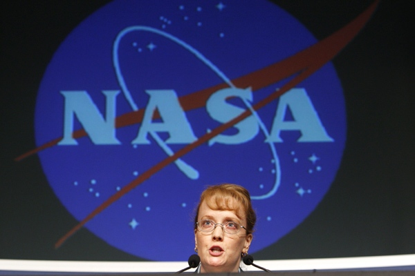 Deputy NASA Administrator Shana Dale makes a statement to reporters at NASA headquarters in Washington on Friday, July 27, 2007. (AP / Charles Dharapak)