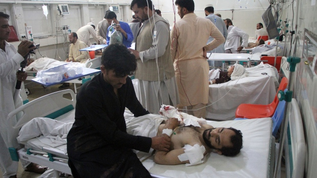 A wounded man receives treatment in Kabul