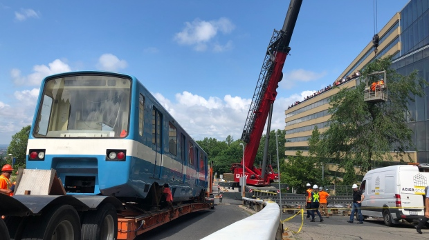 Retired metro car arrives at Ecole Polytechnique
