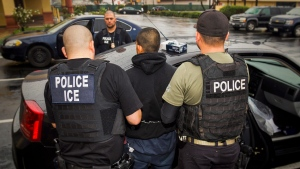 FILE - In this Tuesday, Feb. 7, 2017, photo released by U.S. Immigration and Customs Enforcement, foreign nationals are arrested during a targeted enforcement operation conducted by U.S. Immigration and Customs Enforcement (ICE). (Charles Reed/U.S. Immigration and Customs Enforcement via AP, File)