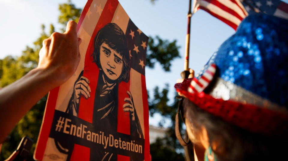 "A sign with ""#EndFamilyDetention"" is held high during a protest with Washington area national and local organizations including CASA, Center for Popular Democracy, Faith in Action, and the Capital Area District 32BJ SEIU in Lafayette Square Park, in Washington, Friday, July 12, 2019, on the immigration policies of the Trump administration. (AP Photo/Carolyn Kaster)"