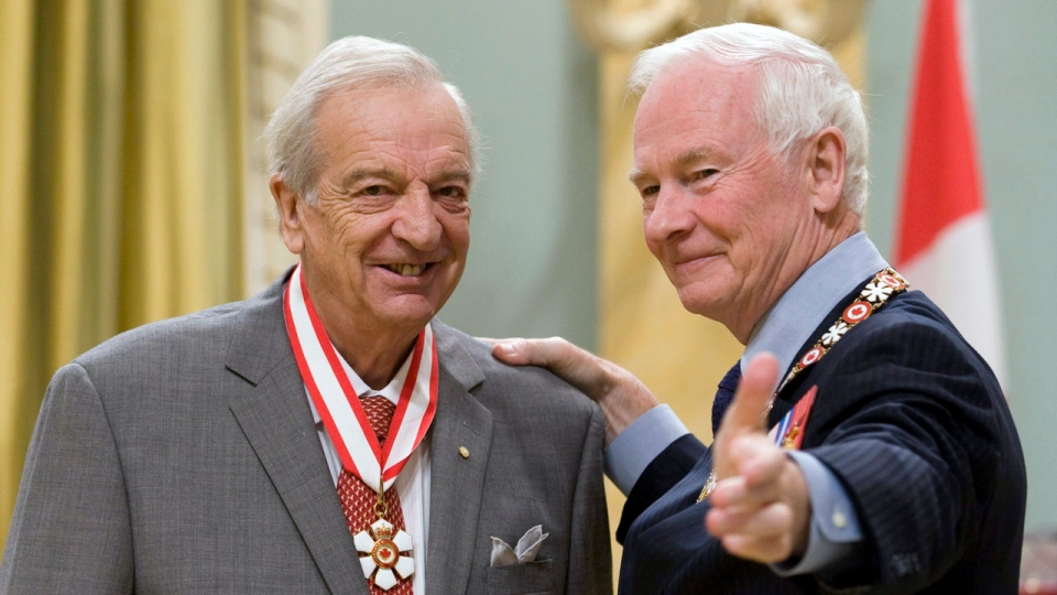 Governor General David Johnston gestures to the cameras with singer Joseph Rouleau, of Montreal, after he became a Companion of the Order of Canada during a ceremony at Rideau Hall in Ottawa, Wednesday, Oct. 17, 2010. THE CANADIAN PRESS/Adrian Wyld